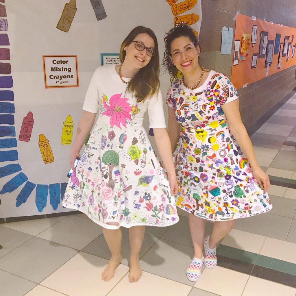 Jennifer Hamilton, art teacher, with Cassandra Birchmeier in dresses with student art printed on them